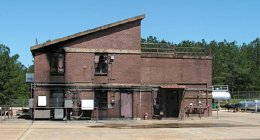 The original Burn Building was constructed in 1974. It has four levels and simulates residential and commercial buildings. Since the completion of the new burn building in 2006, this building has been converted into a self contained breathing apparatus (SCBA) training area and collapse rescue training building. The SCBA training area of the building will simulate collapsed ceilings, walls and floors.